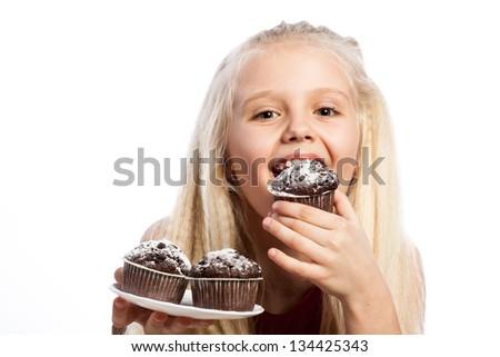 Girl biting a chocolate cake. Isolated on white background. - stock photo