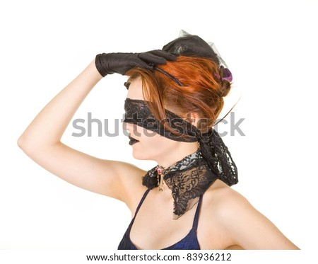 Girl blindfolded and dressed in underwear - stock photo