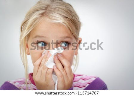 Girl blowing her nose. Space for text. Horizontal - stock photo
