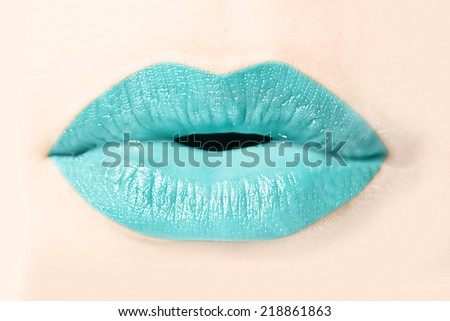 Girl blue lips close up - stock photo