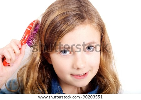 Girl brushing hair - stock photo