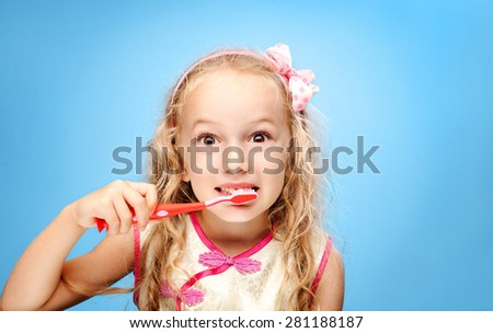 Girl brushing her teeth - stock photo