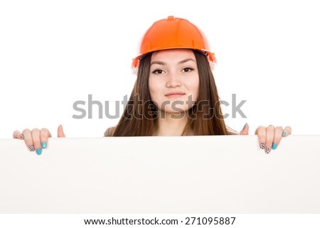 Girl builder in helmet showing a blank banner. Asian cheerful young female model displays ads. Isolated on a white background - stock photo