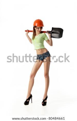 Girl-builder with shovel - stock photo