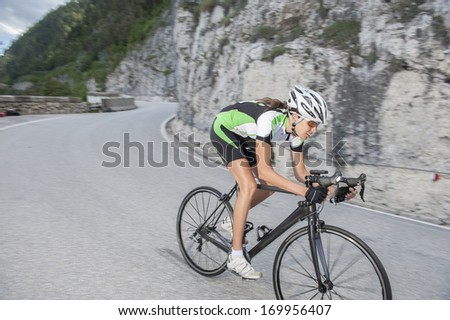 girl by downhill with road cycle - blurred motion - stock photo