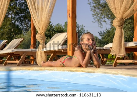 Girl by the poolside - stock photo