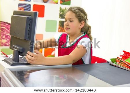 Girl cashier - stock photo