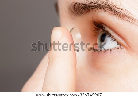 Girl changes the lenses to improve vision - stock photo