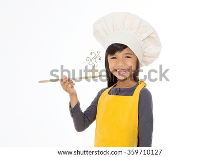 girl chef with wooden spoon isolated on white background - stock photo