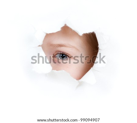 girl child eye in torn paper hole isolated - stock photo
