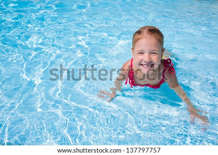 girl child in blue water - stock photo
