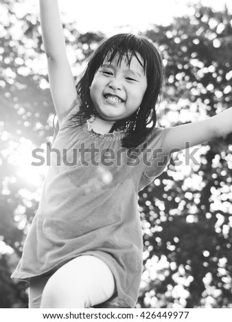 Girl Childhood Smiling Playful Happiness Concept - stock photo