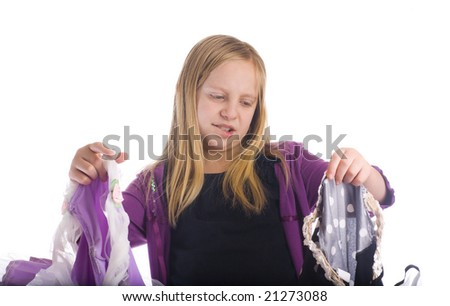 Girl choosing between two costumes or clothes - stock photo