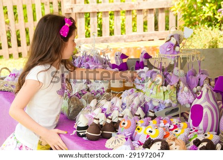 Girl choosing lavender products on Provence market  in France - stock photo
