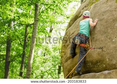 Girl climbing  - stock photo