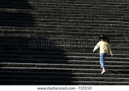 girl climbing the great wall of china - stock photo