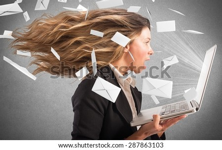 Girl covered with a wind of email - stock photo