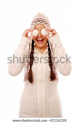 Girl covering eyes with snow balls - stock photo