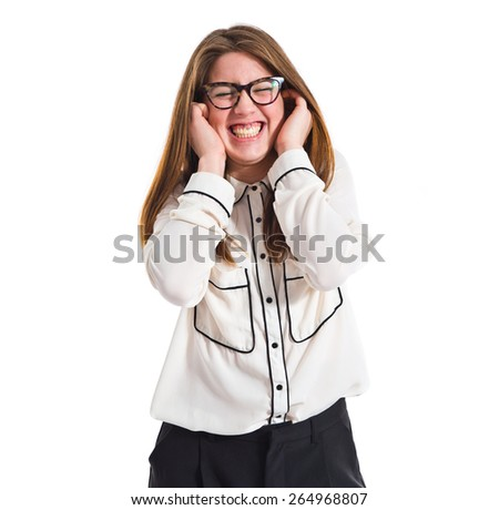 Girl covering her ears  - stock photo