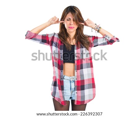 Girl covering her ears over white background. - stock photo