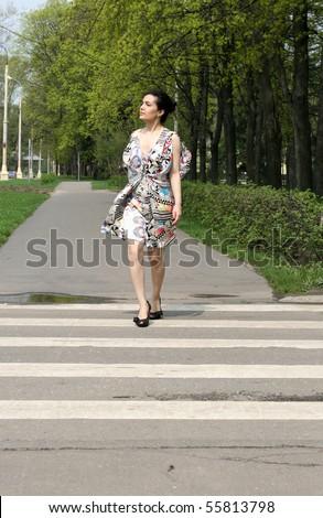 Girl crossing the street - stock photo