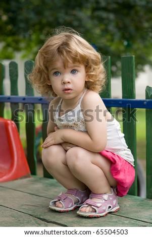 Girl Crouching - stock photo
