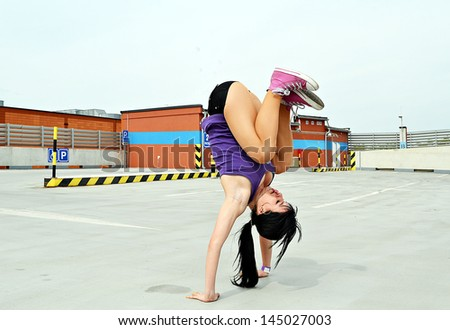 girl dancing on the street breakdance - stock photo
