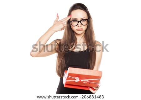 girl disappointed by poor gift to make gestures of suicide - stock photo