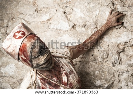 Girl disguised as a zombie nurse - stock photo