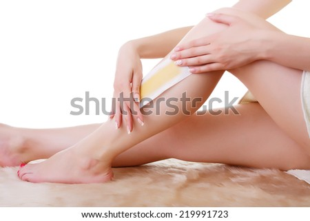 Girl doing depilation with wax on the feet. - stock photo