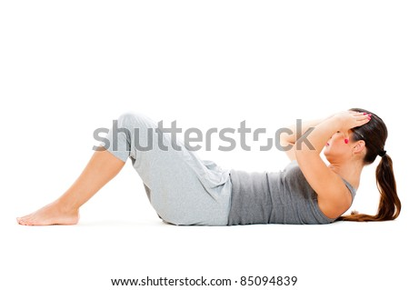 girl doing exercises for abdominal muscles. isolated on white background - stock photo