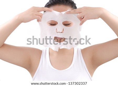 Girl doing facial mask - stock photo