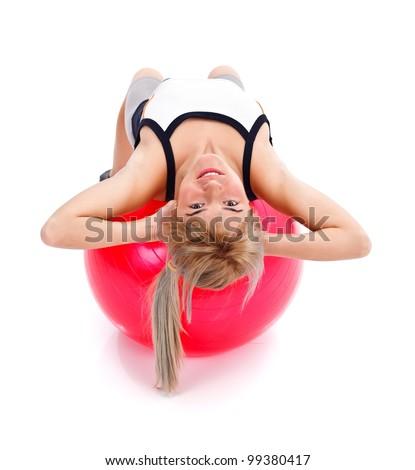 Girl doing fitness on red pilates ball - stock photo