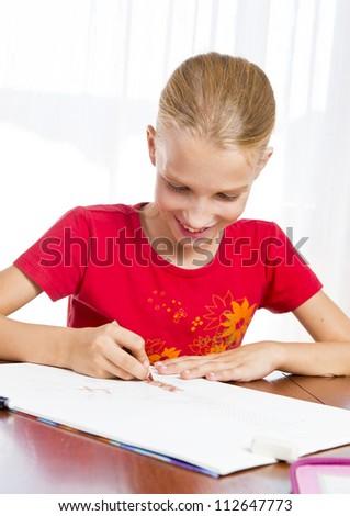 Girl doing her homework - stock photo