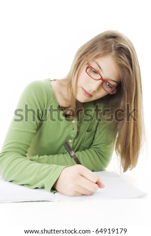 Girl doing homework. Isolated on white - stock photo