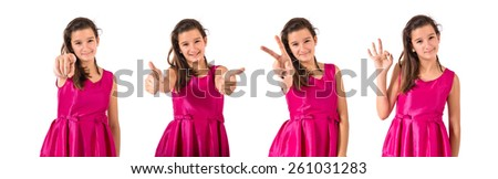 Girl doing victory gesture over white background - stock photo