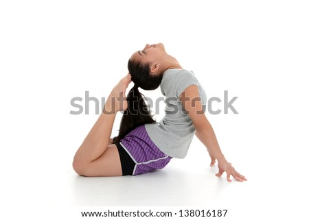Girl Doing Yoga Pose in a Studio - stock photo