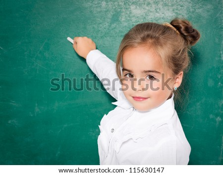 Girl drawing with chalk - stock photo