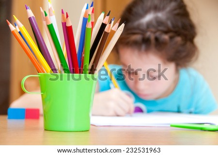 Girl drawing with color pencils - stock photo
