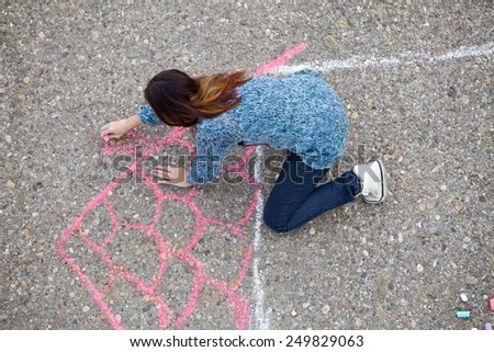 Girl Draws a House - stock photo