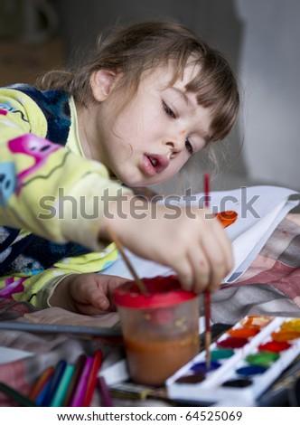 Girl draws on the album - stock photo