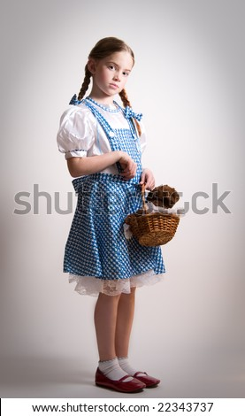 Girl dressed up as Dorothy from Oz - with attitude. - stock photo