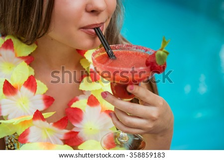 Girl drinking alcoholic cocktail - stock photo