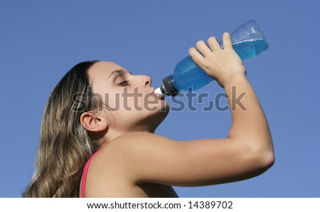 girl drinking an energetic drink - stock photo