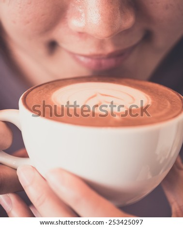 Girl Drinking Coffee in vintage color tone style - stock photo