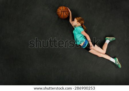 Girl dunking basketball - stock photo