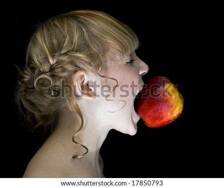 girl,eating apple over the black background - stock photo