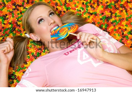 Girl Eating Candy - stock photo