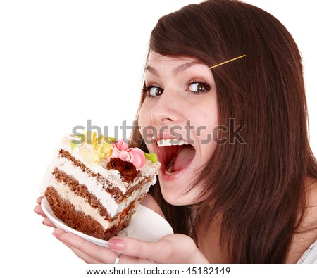 Girl eating piece of cake. Isolated. - stock photo