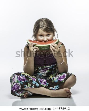 Girl eating watermellon - stock photo